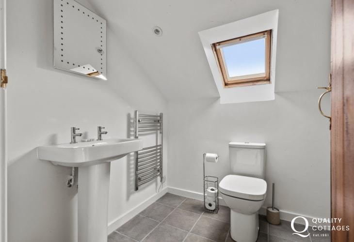 En-Suiteshower room, toilet and washbasin sea views