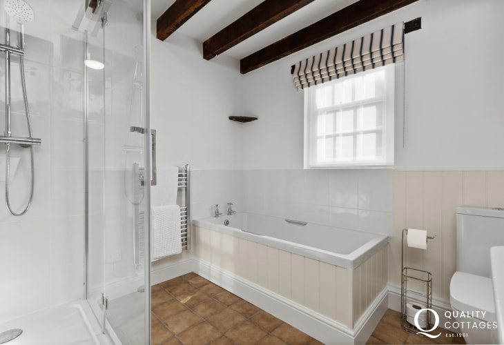 Bathroom on Ground Floor with walk-in twin shower, freestanding bath toilet and washbasin