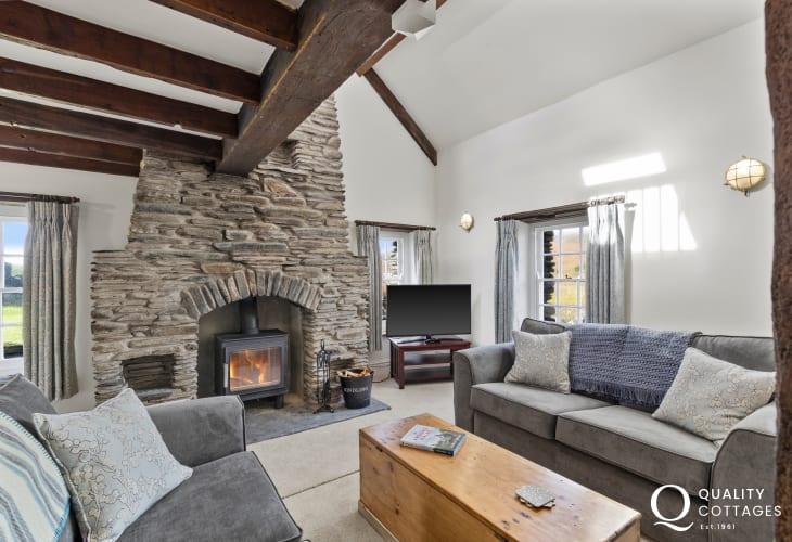 Spacious modern lounge two sofas T.V. log burner