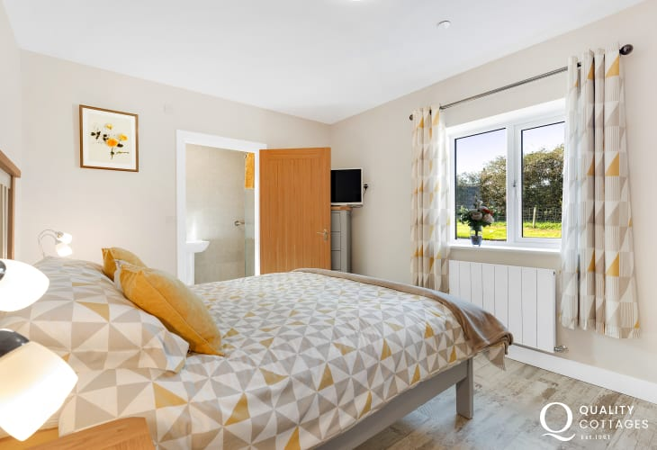 King-size bedroom with rural views and en-suite shower room