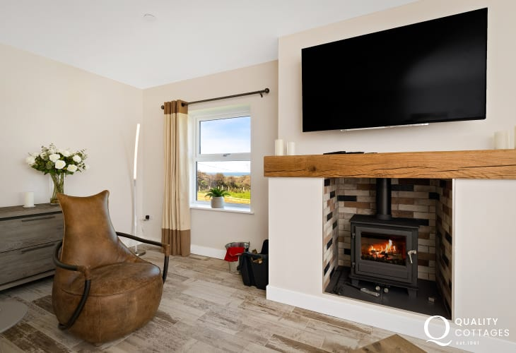 Living roomwith wood-burning stove and views over rolling pasture