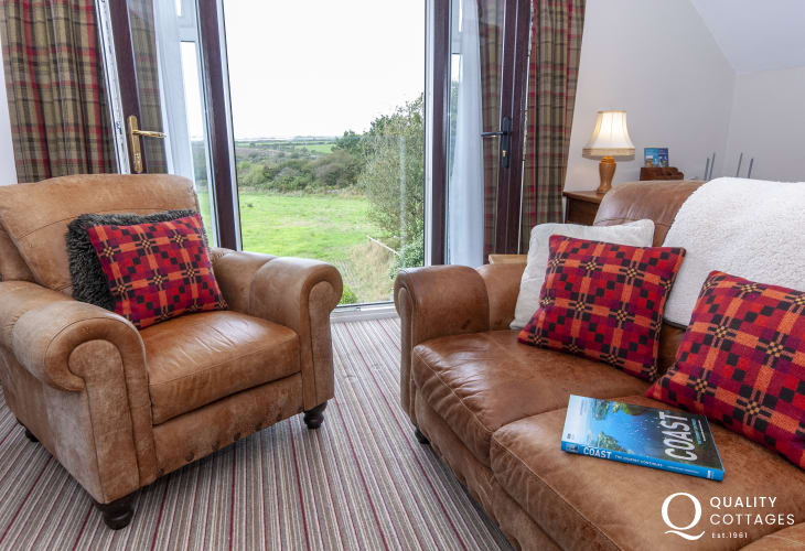 St Davids Peninsula accommodation  - cosy living room with 'Juliet Balcony' and views to Ramsey Island