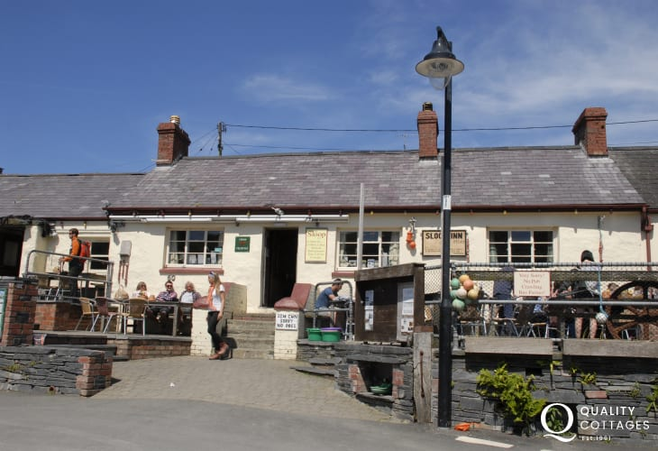 The Sloop Inn - a popular 18th Century pub overlooking the harbour