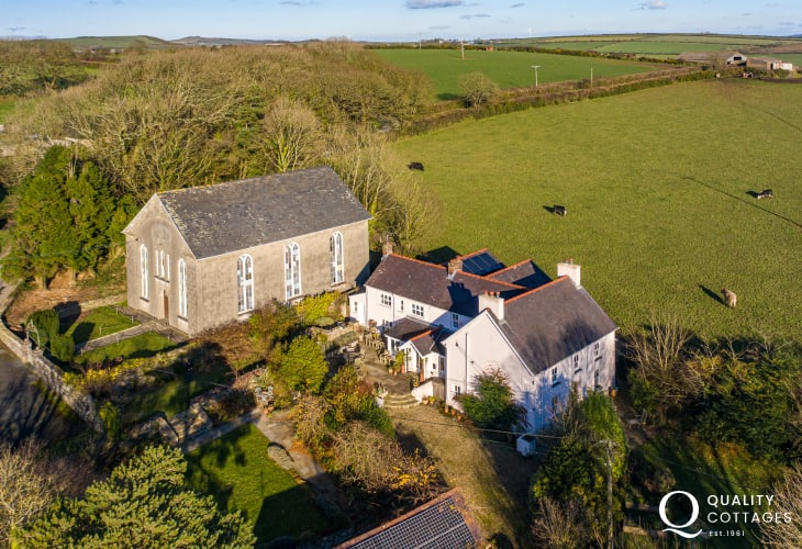 Aerial photograph of dog friendly period holiday cottage, sleeping 15 people on the St Davids Peninsula, Wales.