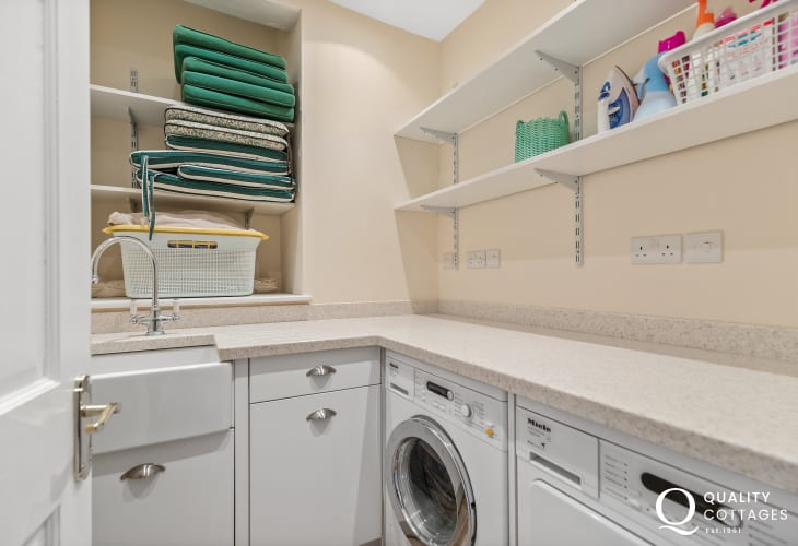 Holiday cottage on the St Davids Peninsula , Wales - utility room with sink, Miele Washing machine and Miele tumble dryer.