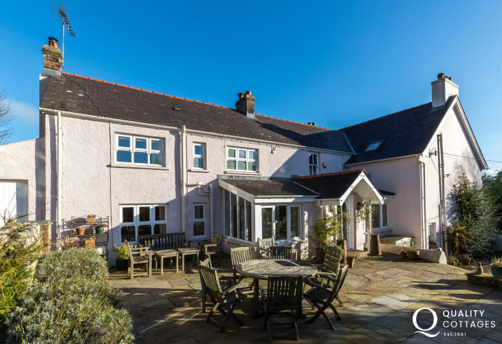 Garden with patio and seating - luxury pet friendly holiday house on St Davids Peninsula, Pembrokeshire. Sleeps 15 people.