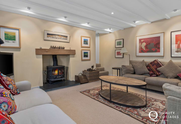 Holiday cottage in St Davids Peninsula hamlet - lounge with log burning stove, comfortable sofas and TV. Sleeps 15 people.