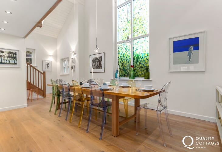 Holiday house on the St. Davids Peninsula, Pembrokeshire - Dining room with bespoke oak table and Philippe Starck chairs.