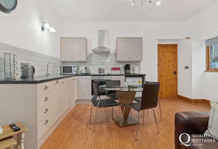 Open-plan kitchen-dining area at Owls Retreat holiday cottage, spacious and light.