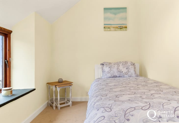 Second bedroom with double bed at Owl's Retreat in West Williamson, Pembrokeshire.