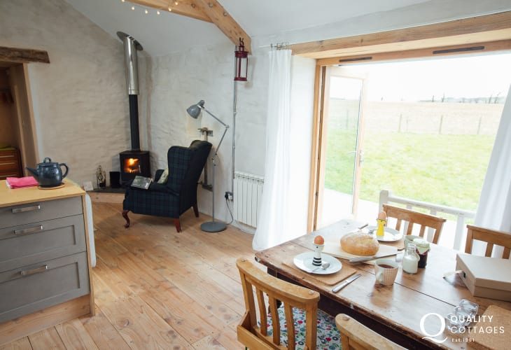 Log burner and easy chair table and four chairs