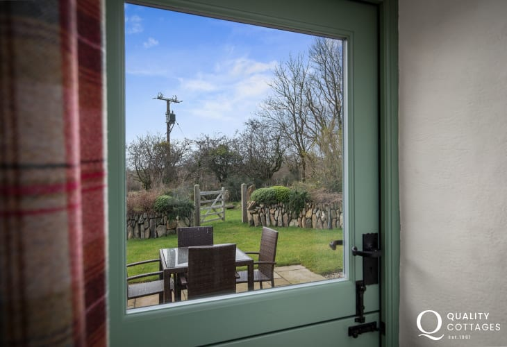 Converted barn holiday cottage near Preseli Mountains, Pembrokeshire - stable door out to patio with rural countryside views.