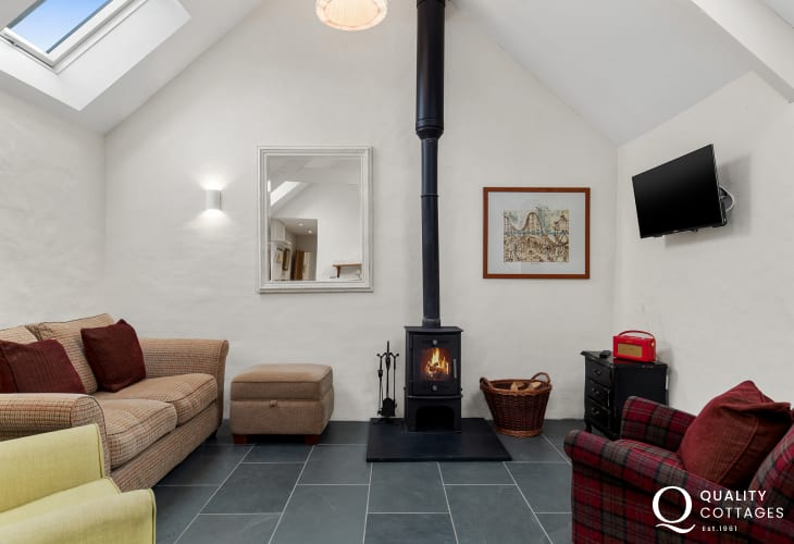 Holiday cottage in rural Pembrokeshire, near the Preseli Mountains - lounge with TV, log burner, sofa and armchairs.