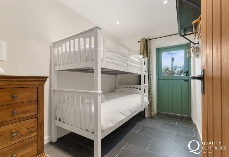 Holiday cottage in Rhosfach, Pembrokeshire countryside, sleeps four - bedroom with bunk beds for two and chest of drawers.