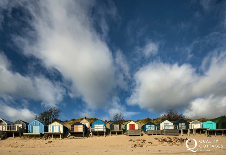 Beach huts at nearby Abersoch, close to Plas Newydd holiday home