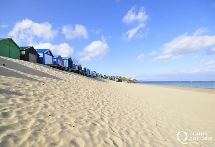 Abersoch beach with it's huts along the bank