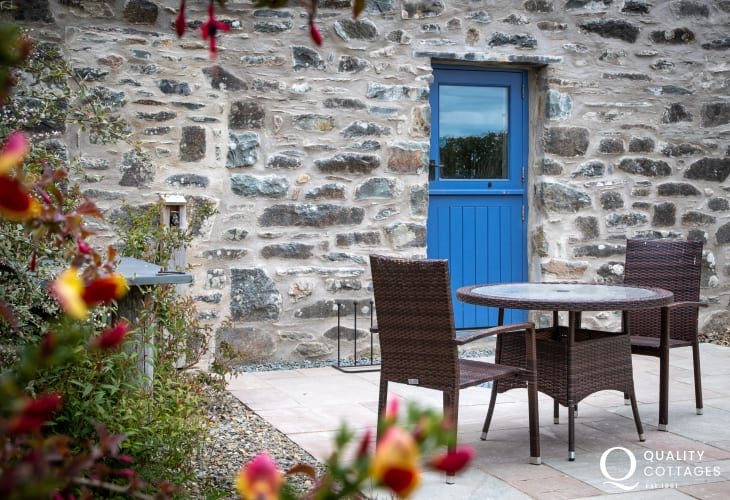 The Mill Preseli Holiday Cottage with patio and bistro table and chairs