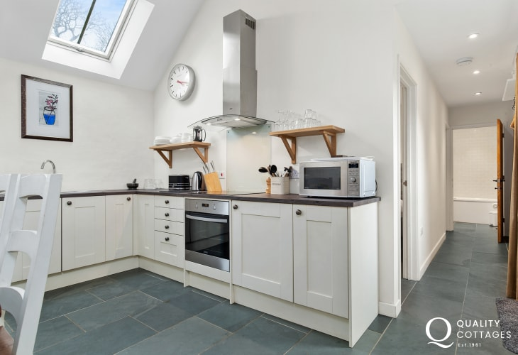 Modern kitchen with white units and a skylight