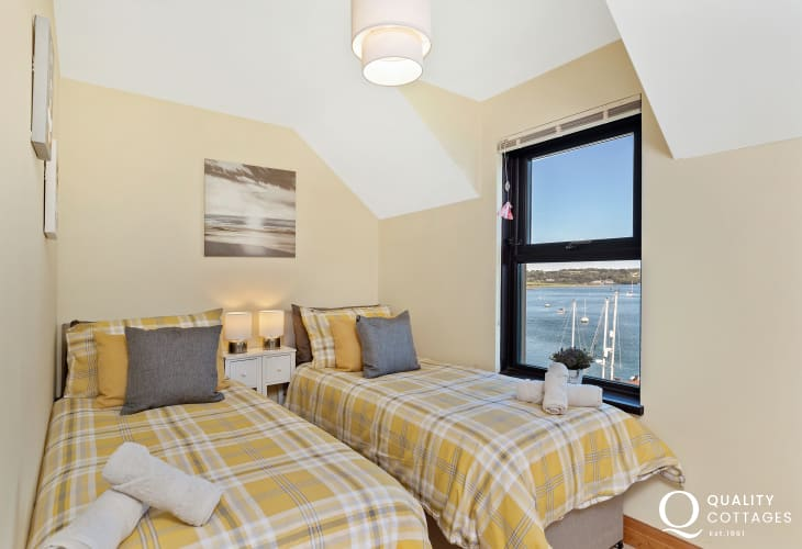 Twin bedroom with views of the waterway.