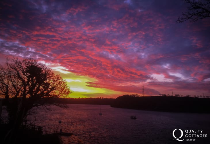 Sunset Pembrokeshire estuary holiday cottage view from garden.