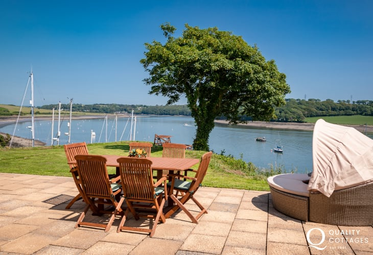Outside dining area with waterway views