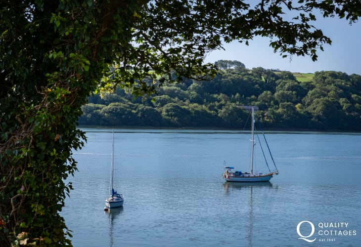 Boats on Pembrokeshire estuary taken from luxury riverside holiday cottage.
