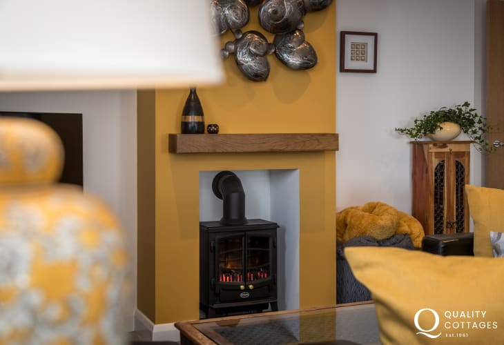 Holiday cottage in North Wales with cosy fire in lounge area.