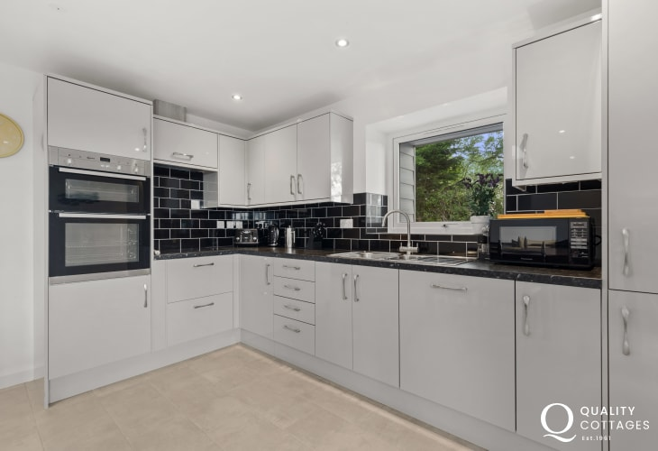 Luxury holiday cottage on the Llyn Peninsula, North Wales - kitchen with electric hob, oven, dishwasher and fridge/freezer.
