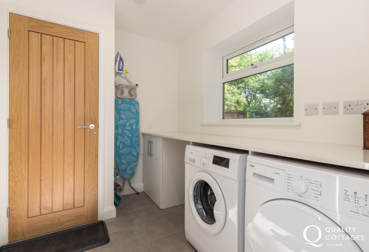 Holiday cottage near the Llyn Peninsula and Snowdonia - utility room with washing machine and tumble dryer.