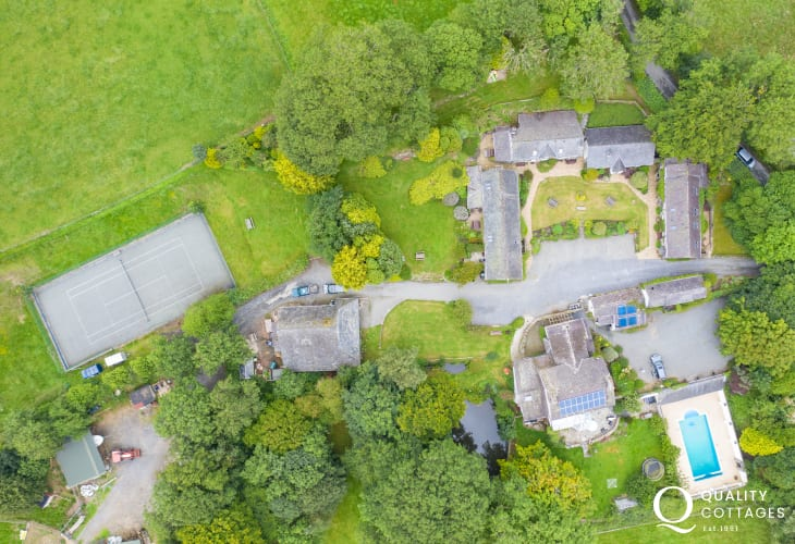 Aerial view of coastal holiday cottage in New Quay, Cardigan Bay, Wales. Sleeps four people with tennis court and pool.