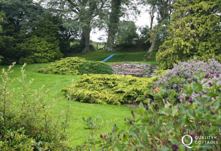 Rural holiday cottage in New Quay, Cardigan Bay, Wales. Sleeps four people with tennis court and large gardens.