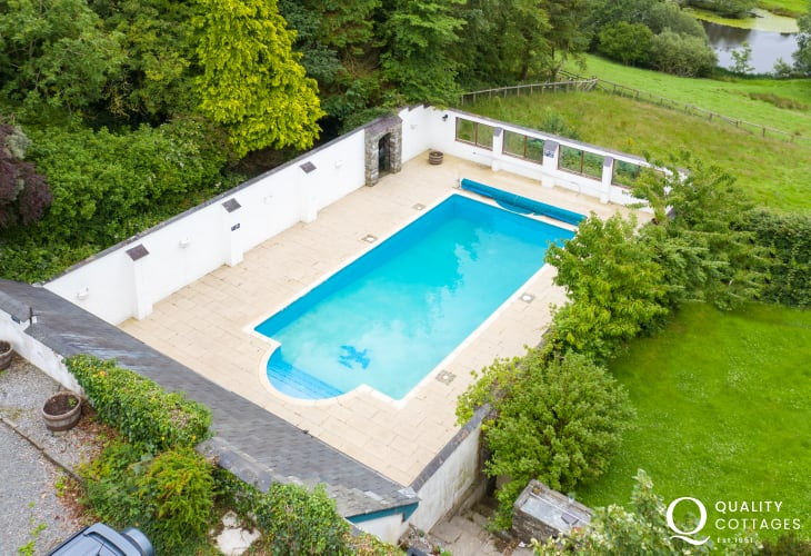 Aerial view of the outdoor swimming pool for coastal holiday cottage in New Quay, Cardigan Bay, Wales.