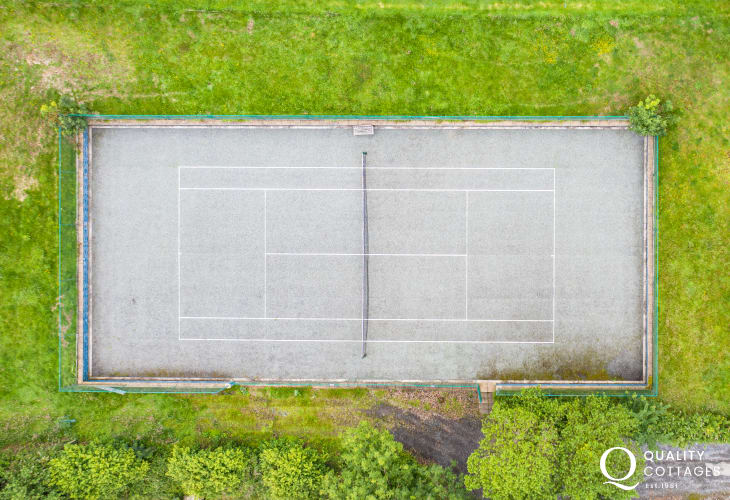 Aerial view of the tennis court for coastal holiday cottage in New Quay, Cardigan Bay, Wales. Sleeps four people.