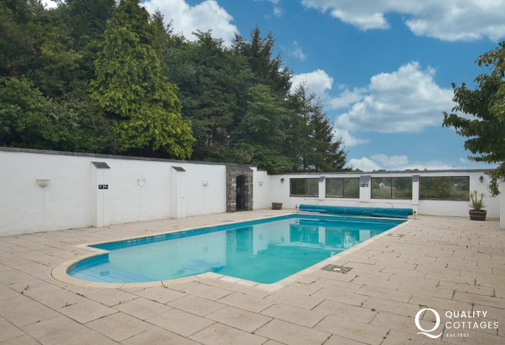 Outdoor swimming pool for coastal holiday cottage in New Quay, Cardigan Bay, Wales.