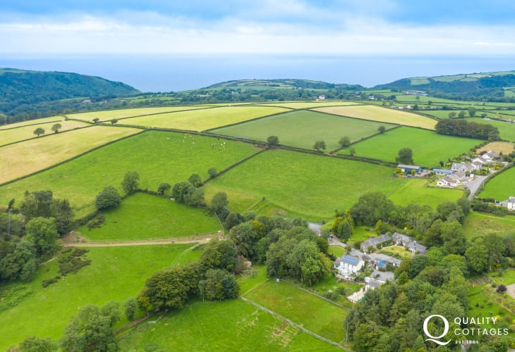 Aerial view of rural holiday cottage in New Quay, Cardigan Bay, Wales. Sleeps four people with tennis court and large gardens