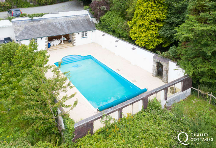 Outdoor swimming pool of holiday cottage in  New Quay, Cardigan Bay. Sleeps four people.
