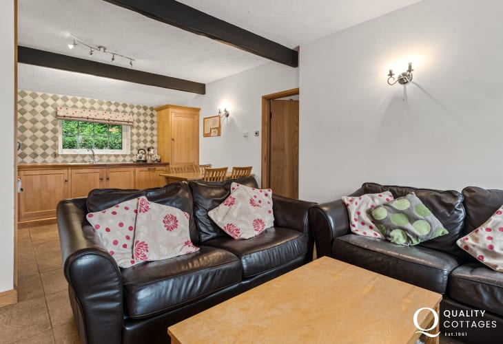 Leather sofas in coastal holiday cottage in New Quay, Cardigan Bay, Wales. Sleeps four people.