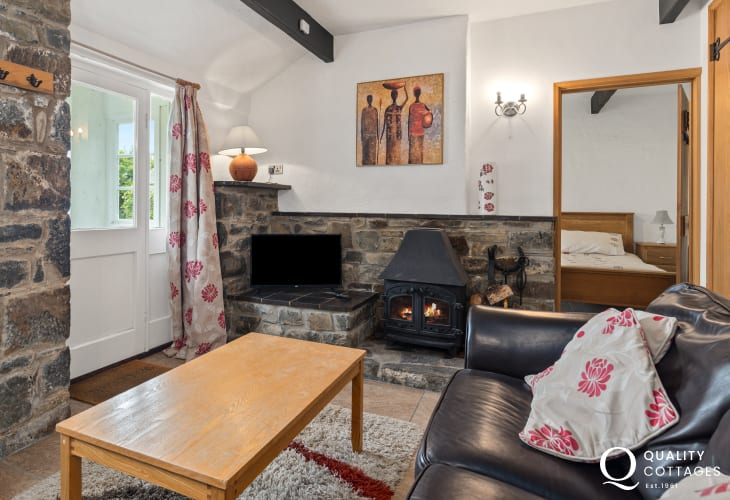 Living room of coastal holiday cottage in New Quay, Cardigan Bay with log burner.