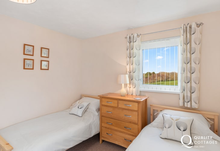 Twin bedroom with rural views over golf course and fairway - golfing holiday apartment in Pembrokeshire, Wales.
