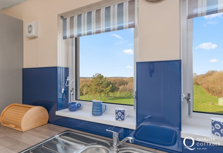 Holiday apartment in Pembrokeshire on golf course - modern kitchen with pleasant countryside and fairway views.