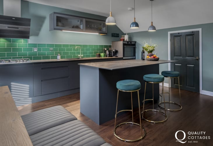 Holiday apartment in St Davids, Pembrokeshire - designer Kitchen with stunning splashback, statement island and stools.