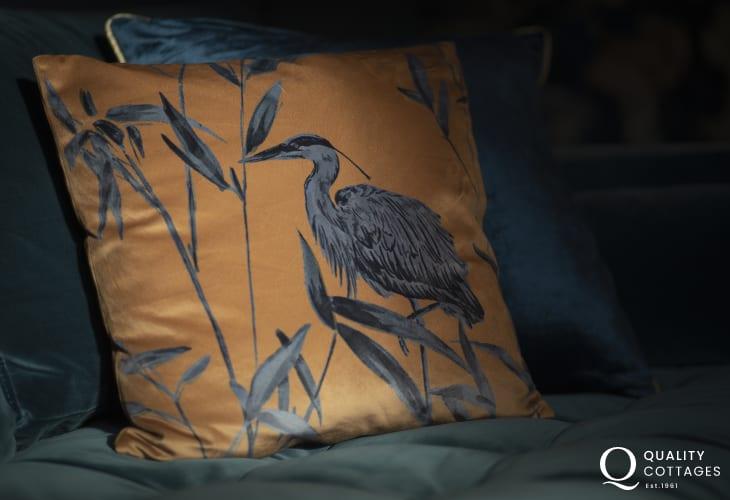 Statement cushion on velvet sofa in St Davids holiday apartment