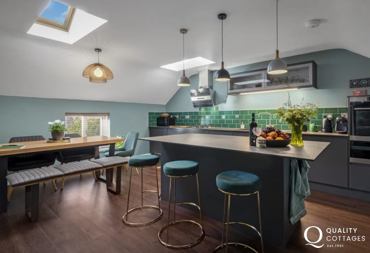 Holiday apartment in St Davids, Pembrokeshire - kitchen/diner with island, dining table and seating for six.