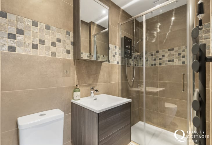Holiday apartment in St Davids city. Modern ensuite shower room with wash basin and WC.
