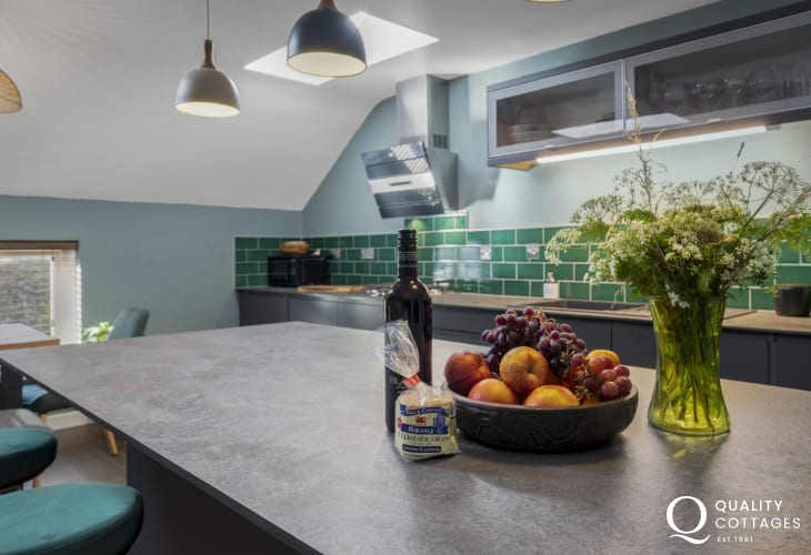 Kitchen with top of range appliances and central island