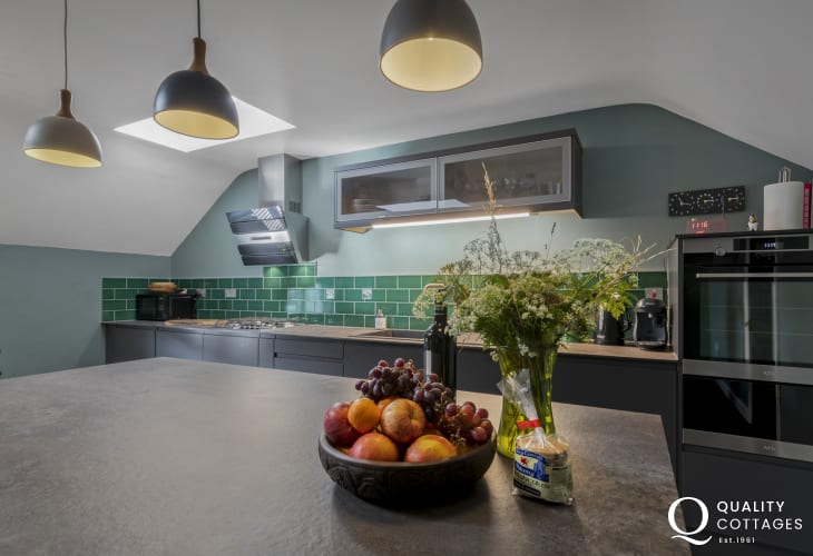 Designer Kitchen with top of range appliances and island inside holiday apartment in St Davids, Pembrokeshire. Sleeps five.