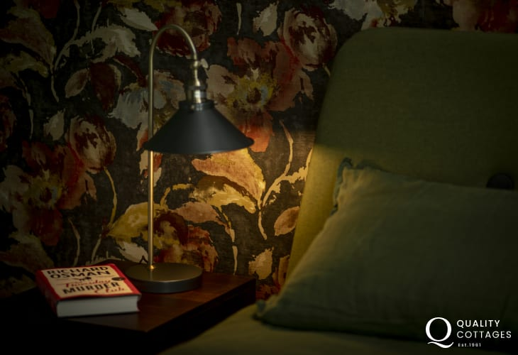 Luxury holiday apartment in St Davids, Pembrokeshire -bedside table and reading lamp in king-size main bedroom.