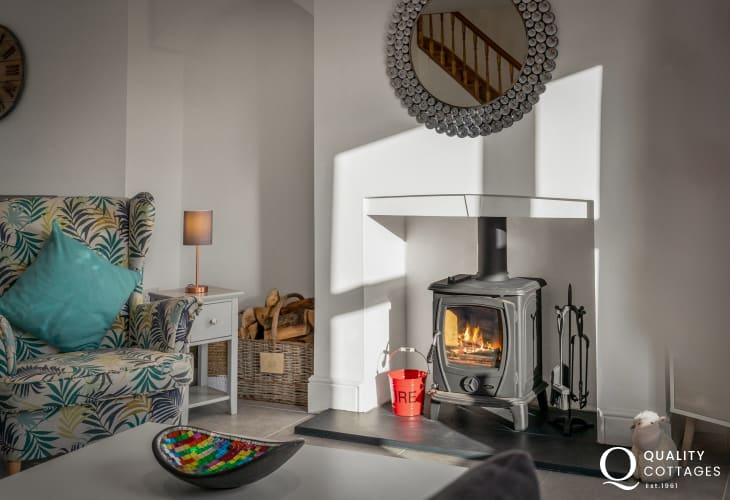 Holiday cottage near Narberth, Pembrokeshire - modern lounge area with rural views, stylish armchairs and wood-burner.