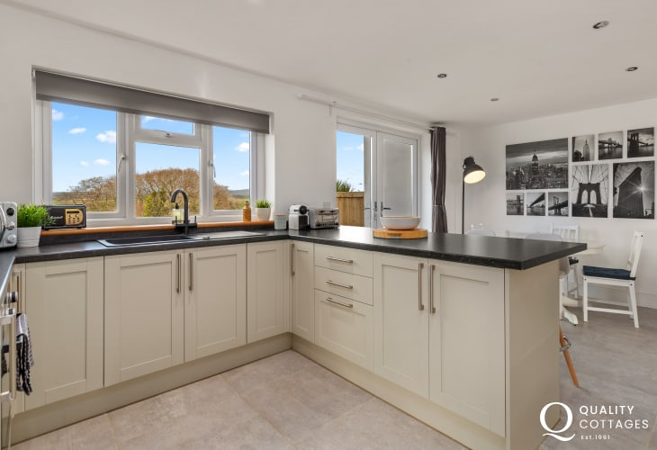Holiday cottage in Llawhaden, near Narberth, Pembrokeshire - Open plan kitchen-diner with patio doors to enclosed garden.