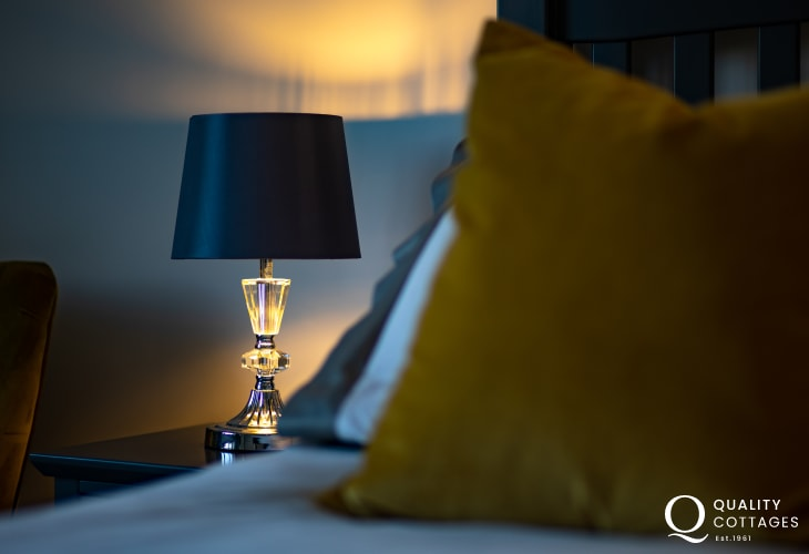 Bedside table lamps in bedroom of stylish holiday cottage near Narberth, Pembrokeshire. Sleeping four.